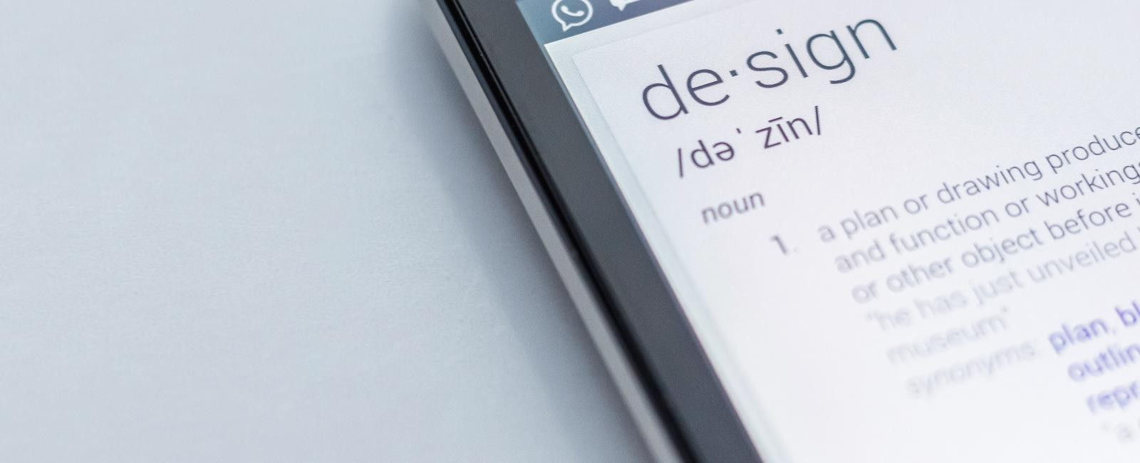 Close up of the definition of design on a smartphone.