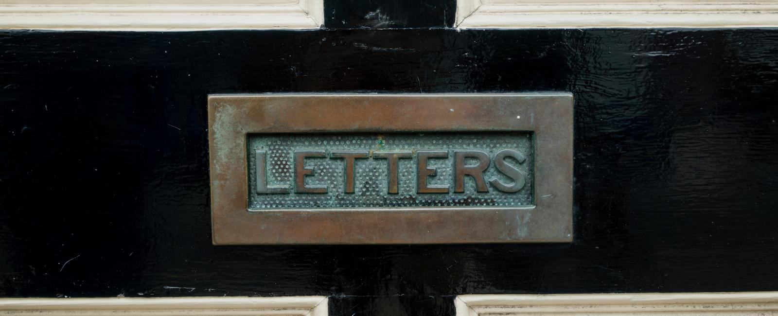 A letter slot in a door