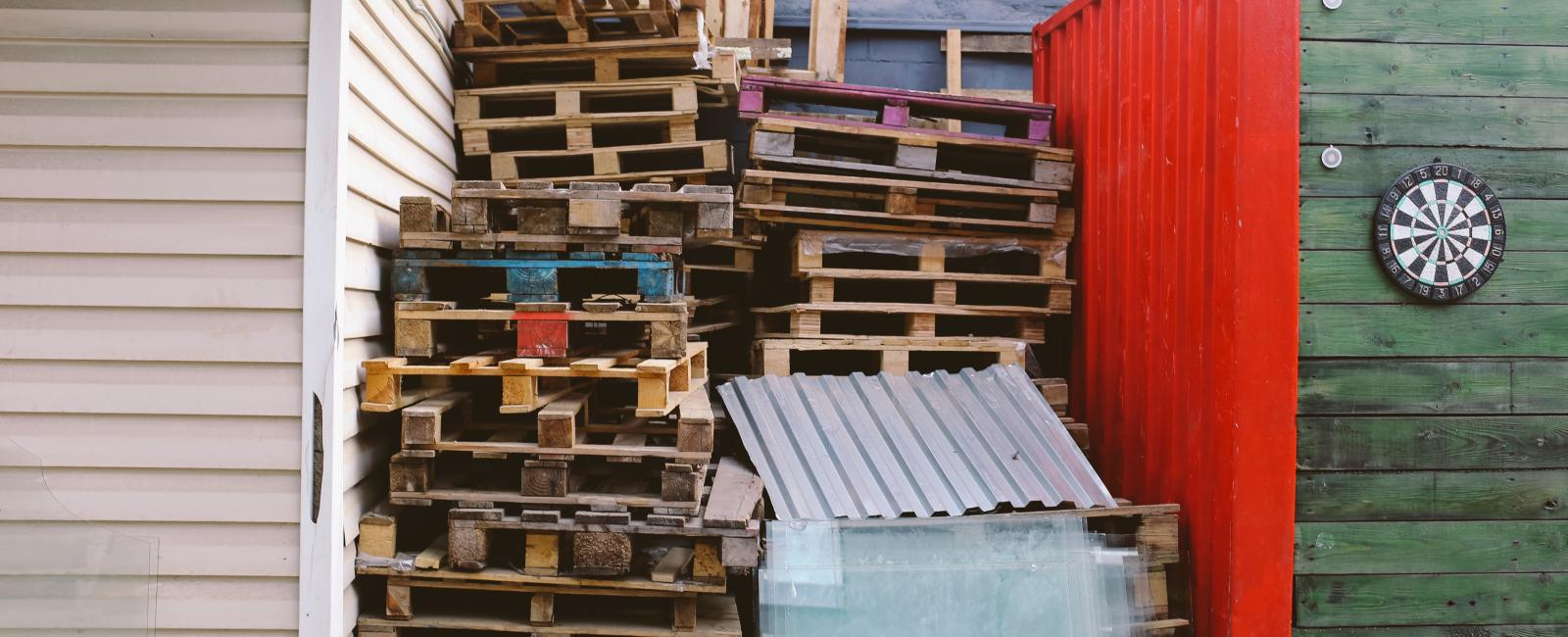 Dumpster and wooden pallets