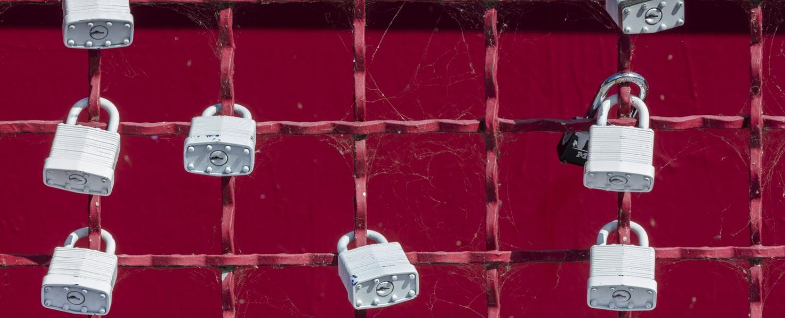 Locks on a red fence